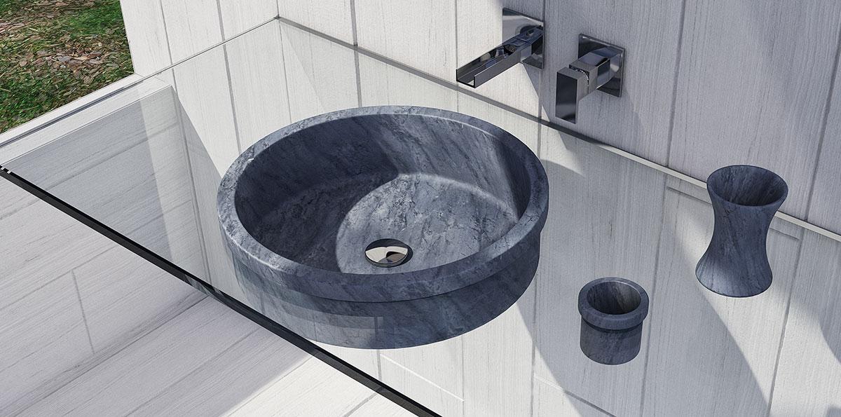 lavandino grigio scuro in marmo con accessori da bagno