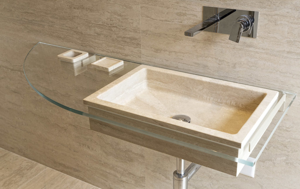 Travertine sink on glass top