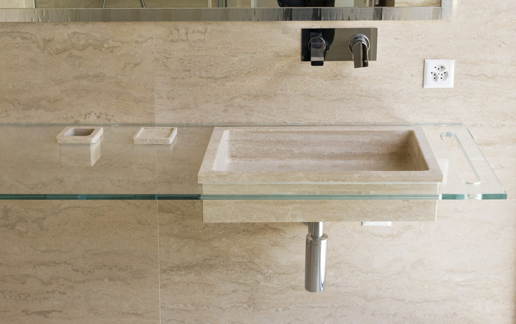 Sink and Wall Covering in Travertine