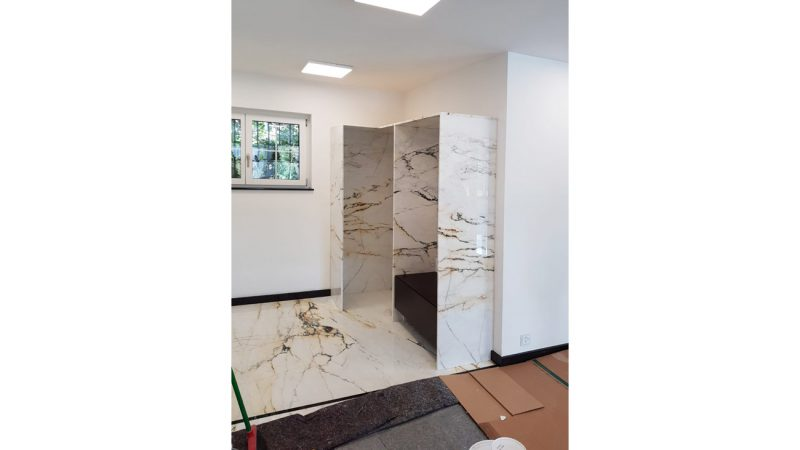 Laying of the Paonazzo marble floor and marble cabinet