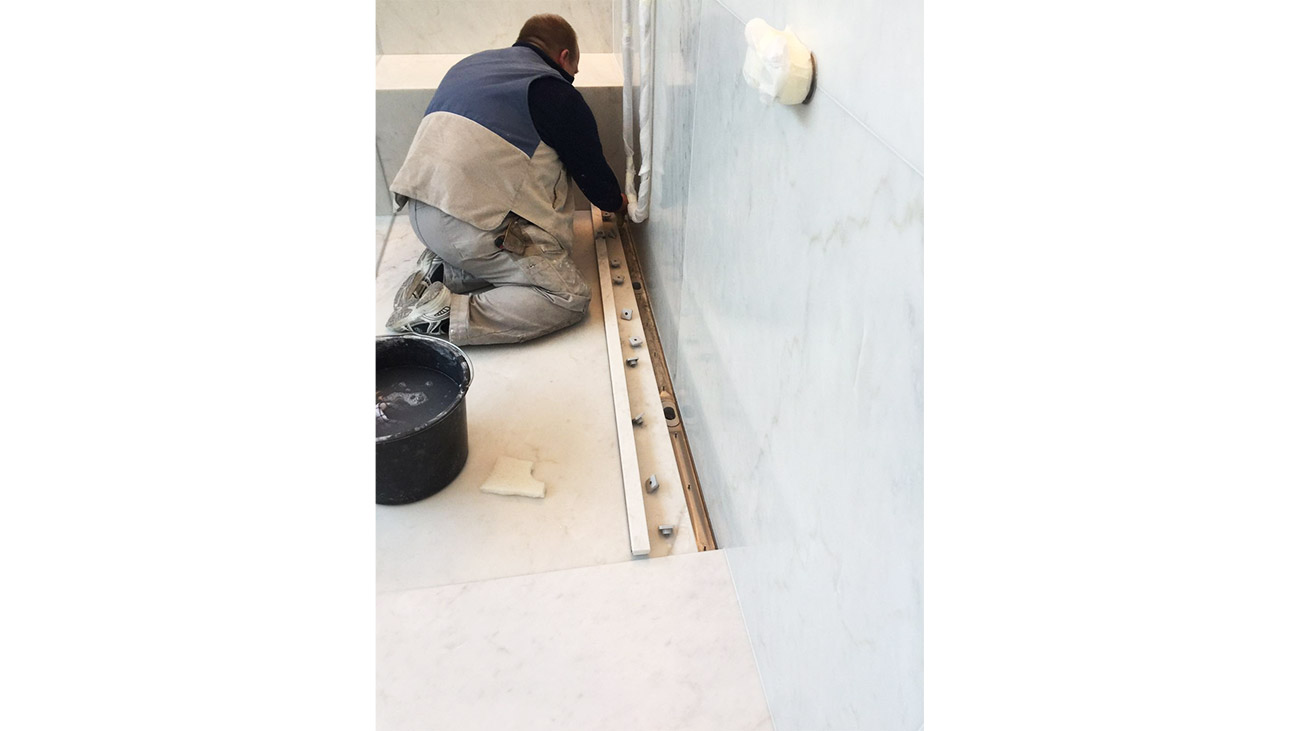 Installation of the drain channel of the marble shower tray