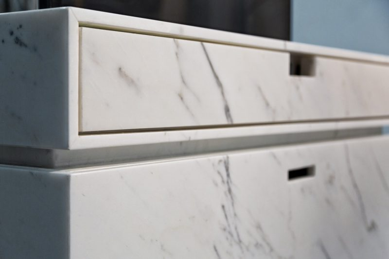 Motorized lift tv cabinet in marble by Dedalo Stone in Carrara
