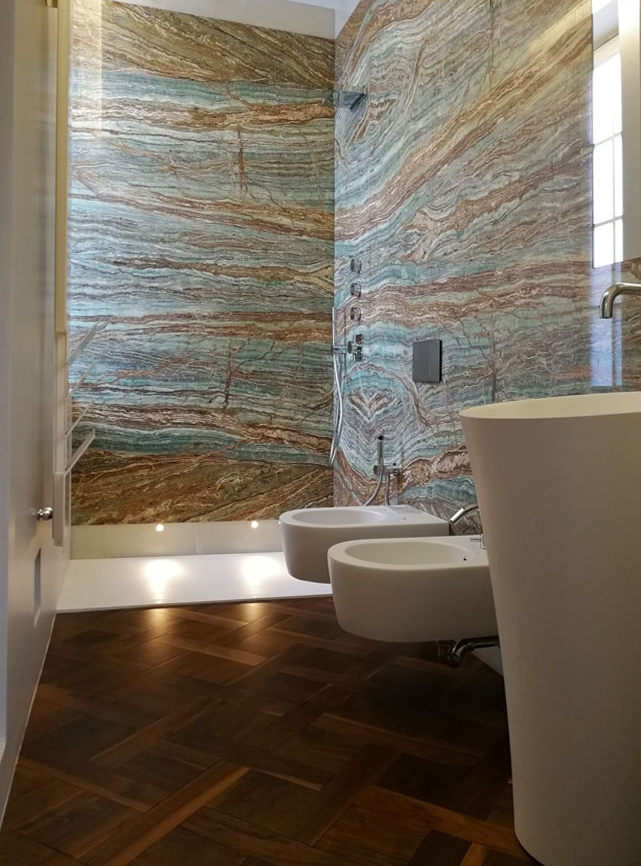 Onyx bathroom shower with bookmatch wall