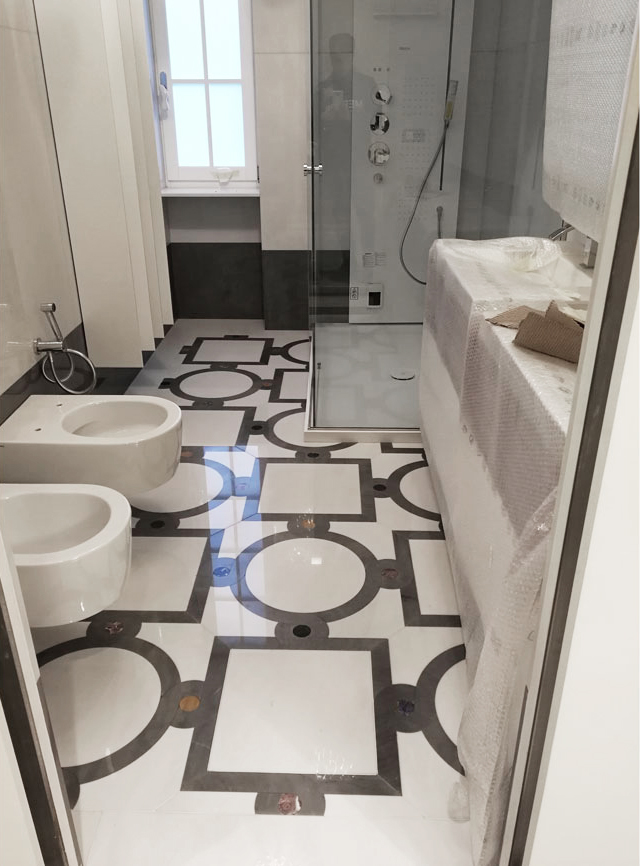 Pavimento intarsi in marmo geometrici