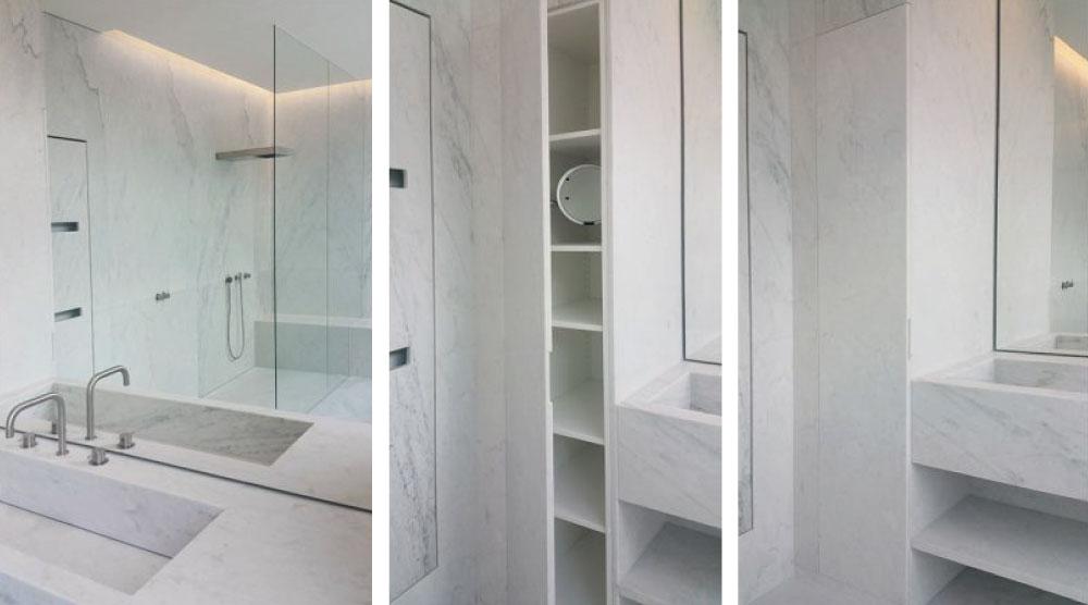 lavandino e rivestimenti in marmo bianco