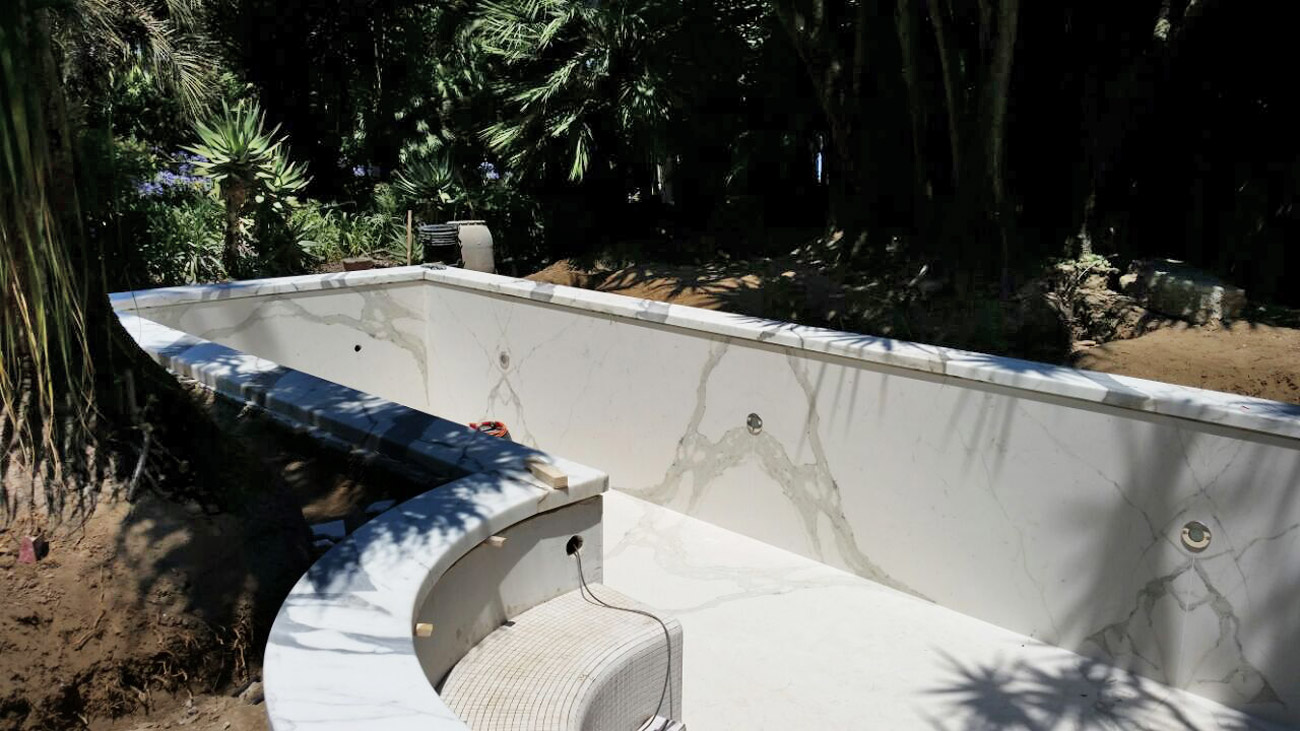 Swimming pool cladding white marble statuario from Carrara
