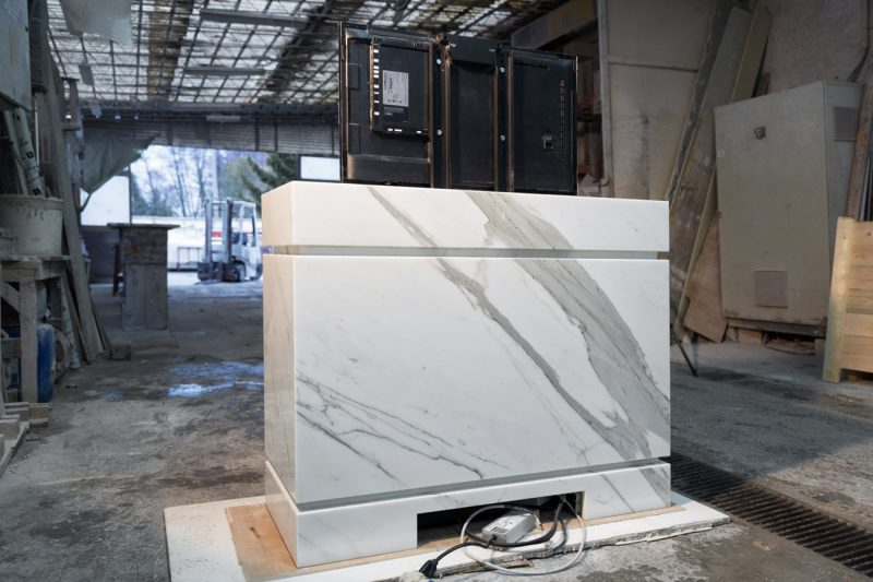 white tv lift cabinet in marble