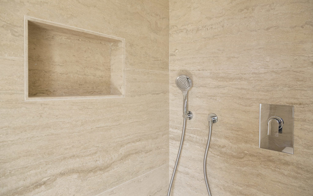 travertine marble cover and wall in shower