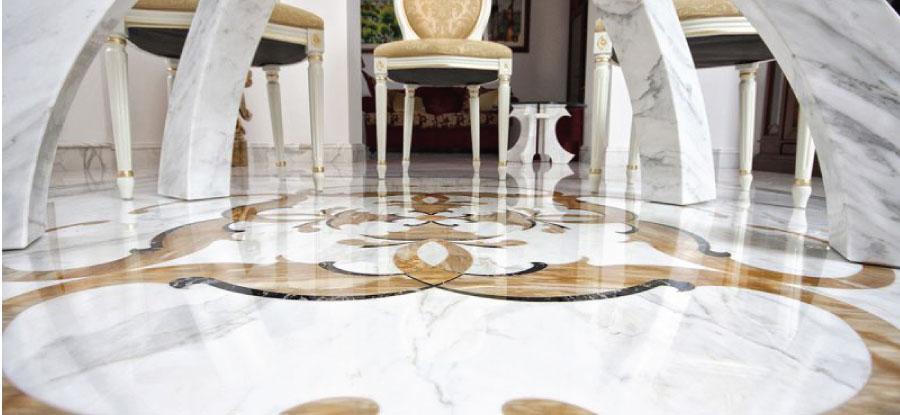 paviemento intarsiato in marmo bianco