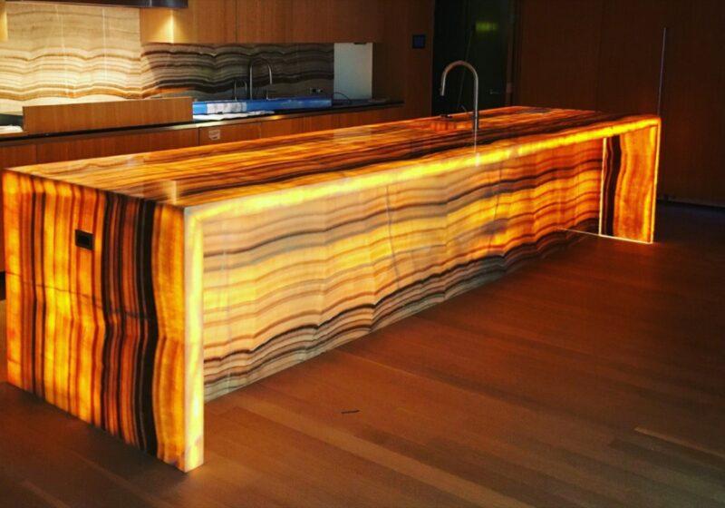 kitchen island in backlit onyx