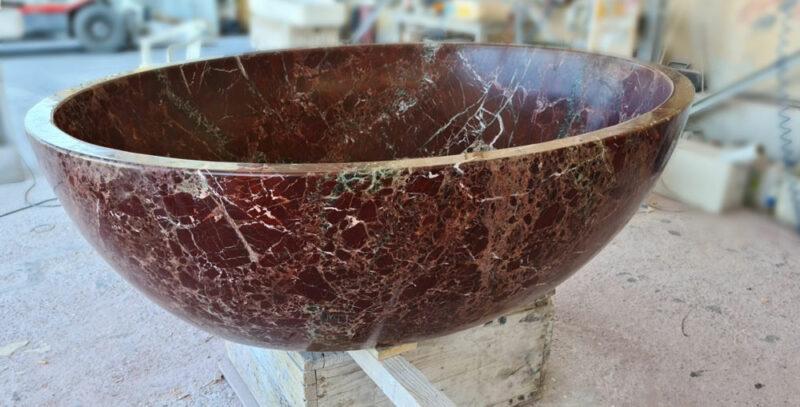 vasca circolare in marmo rosso levanto